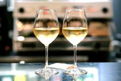 Two wine glasses in bar. Date time for loving people inside restaurant or cafe Stock Image