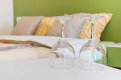 Two wine glasses in bedroom Stock Photo