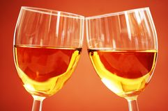 Two wine glasses on the biege. Background Royalty Free Stock Image