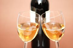 Two wine glasses and a bottle stock photography