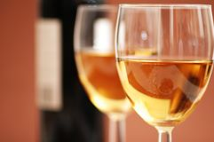 Two wine glasses and a bottle  Stock Images