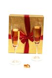 Two wine glasses and  box. Two wine glasses, box and wedding rings Stock Photography