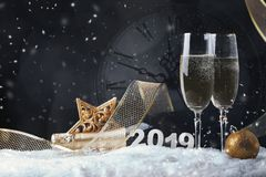 Two wine glasses with champagne, clock and Christmas ornaments on a black background with reflection stock photos