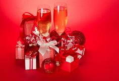 Two wine glasses with champagne and gift boxes Royalty Free Stock Photography