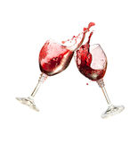 Two Wine Glasses Clinking Together in a splashy Toast. At the white backgroung . Red Wine Stock Image