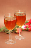Two wine glasses and flowers Stock Image