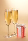 Two wine glasses and gift box Stock Images