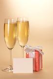 Two wine glasses, a gift box with empty card Stock Photo