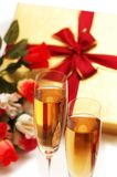 Two wine glasses and giftbox. Two wine glasses, gift box and flowers Royalty Free Stock Photos