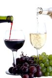 Two wine glasses with grapes Royalty Free Stock Photo