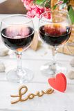 Two wine glasses with heart and letters Love.  Royalty Free Stock Photo