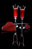 Two wine glasses and hearts Stock Images