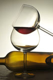 Two Wine Glasses with Horizontal Bottle Royalty Free Stock Photography