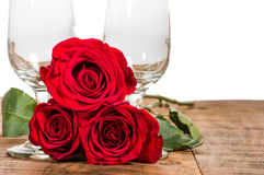 Two wine glasses and red roses Stock Image