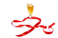 Two wine glasses and red tape stock images