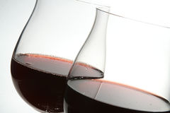 Two wine glasses with red wine stock images