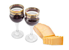 Two wine glasses with red wine and hard cheese Stock Photo