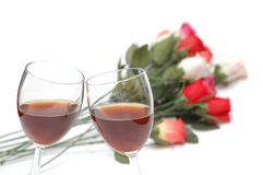 Two wine glasses and roses at Royalty Free Stock Photo