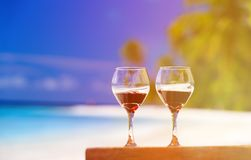 Two wine glasses on sand beach Stock Photo