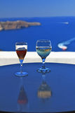 Two Wine glasses with Santorini backdrop Royalty Free Stock Photos