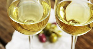 Two wine glasses served with olives stock video footage