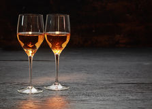 Two wine glasses standing on stone surface royalty free stock photos