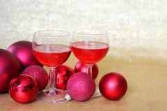 Two Wine Glasses Toast by Christmas Bulb Decorations Royalty Free Stock Photos