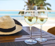 Two wine glasses with white wine at sky and sea background Royalty Free Stock Photos