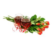 Two wine glasses with wine and a bouquet of rose Royalty Free Stock Photo