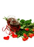 Two wine glasses with wine, hearts and a bouquet o Royalty Free Stock Images