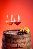 Two wine glasses on a wooden barrel Stock Photos