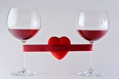 Two wine glasses wrapped with tape and heart Stock Images
