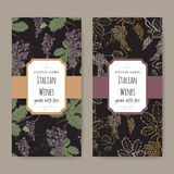 Two wine labels with color grapevine pattern on black background. Royalty Free Stock Images