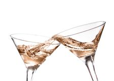 Two wine swirling in a goblet martini glass,. Isolated on a white background royalty free stock photo