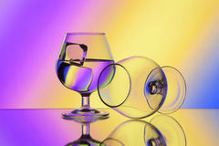 Two wineglases on gradient background Royalty Free Stock Photography
