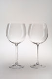Two Wineglasses. Two Elegant Wineglasses Isolated On Gray Background Royalty Free Stock Image