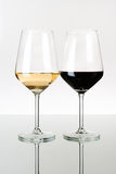 Two Wineglasses. Two Elegant Wineglasses With Red and White Wine On Gray Background Royalty Free Stock Photography