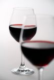 Two Wineglasses. Filled with red wine Stock Image