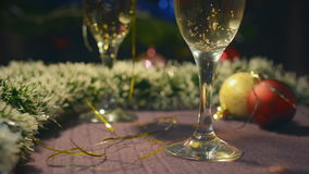 Two Wineglasses Of Champagne. New Year and Christmas Celebration with Champagne. Two Wineglasses of Sparkling Wine. Holiday Decorations stock footage