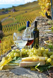 Two wineglasses, cheese and grapes royalty free stock image