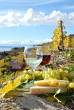 Two wineglasses, cheese and grapes stock photos
