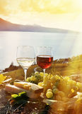 Two wineglasses, cheese and grapes Royalty Free Stock Images