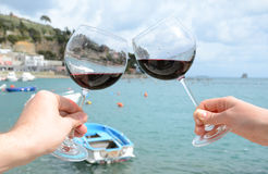 Two wineglasses in the hands Royalty Free Stock Images