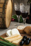 Two wineglasses, olives, cheese and bread are on sacking. Two wineglasses, olives, cheese and white bread are on sacking Royalty Free Stock Images