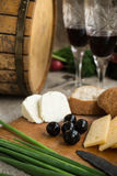Two wineglasses, olives, cheese and bread are on sacking. Two wineglasses, olives, cheese and white bread are on sacking Stock Photo