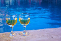 Two wineglasses at the poolside Royalty Free Stock Photography