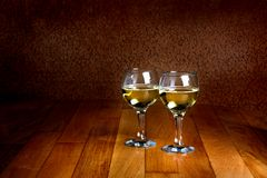 Two wineglasses of white wine Royalty Free Stock Photos