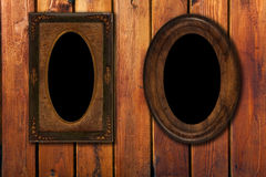 Two wintage photo-frames on wooden background. Two empty wintage photo-frames on old wooden wall Stock Photos