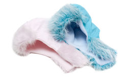 Two winter baby fur hats, rose and blue Royalty Free Stock Photography
