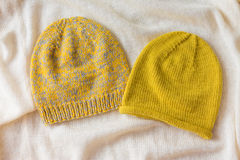 Two winter cap on whaite background Royalty Free Stock Photo